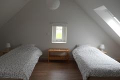 De zolder-slaapkamer met 4 slaapplaatsen